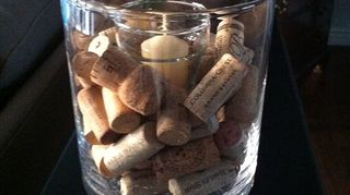 q wine cork ideas for christmas, christmas decorations, crafts, repurposing upcycling, seasonal holiday decor, Large clear glass candle holder with two voltive holders inside One is upside down and covered by the corks it gives a stable and flat footing to the top voltive holder