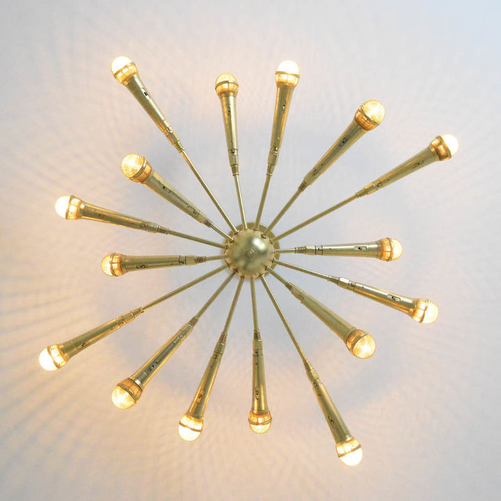 Sputnik chandelier made of gold microphones.