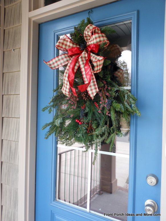 https://cdn-fastly.hometalk.com/media/2014/12/08/1754603/ideas-for-christmas-front-door-with-swag-lighted-branches-christmas-decorations-crafts-seasonal-holiday-decor.jpg?size=786x922&nocrop=1
