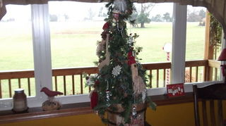 q how to decorate a rustic christmas tree, christmas decorations, crafts, diy, seasonal holiday decor, I have a smaller version of your tree I put it in a bucket and added a hand painted burlap sign to the front of the bucket Mine has Santa ornaments and white lights