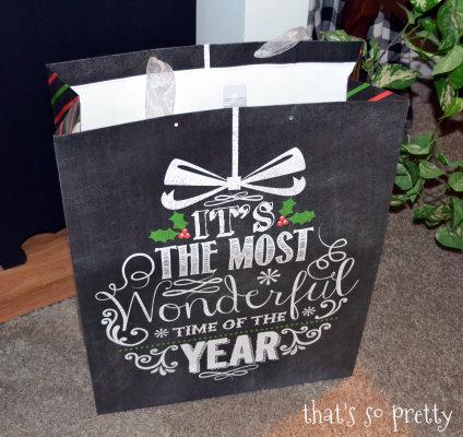 inexpensive christmas gift bag turned christmas wall art, christmas decorations, crafts, seasonal holiday decor