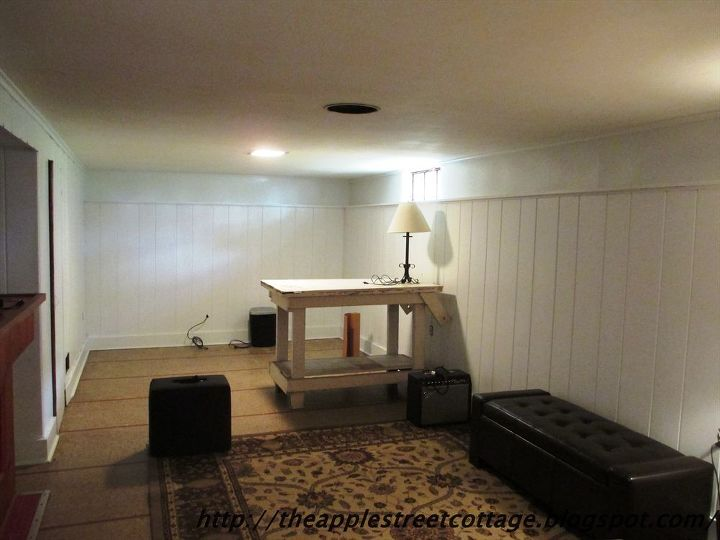 Basement wall panels painted in white hometalk How to disguise wood paneling