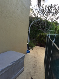 q outdoor shower, outdoor furniture, outdoor living, another angle pool on right house on left