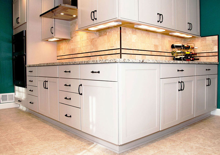 Contemporary limestone painted cabinetry.