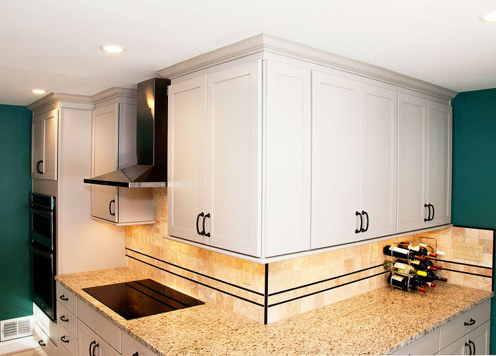 Painted shaker style cabinets.