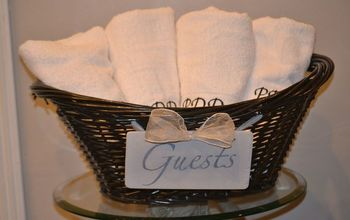 repurpose an old basket into guest room or guest bath d cor, bathroom ideas, crafts