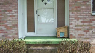 q porch on a brick ranch, concrete masonry, curb appeal, porches, This is old photo of my porch A lot has changed New lights new storm door green carpet gone