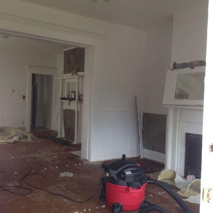 https://cdn-fastly.hometalk.com/media/2015/02/09/2363866/1920-duplex-remodel-bathroom-ideas-dining-room-ideas-fireplaces-mantels.JPG?size=634x922&nocrop=1
