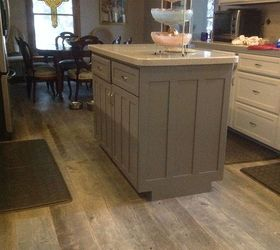 colors in our kitchen are shown in the other photo white cabinets pale gray walls darker gray island weathered wood porcelain floors and gray speckled