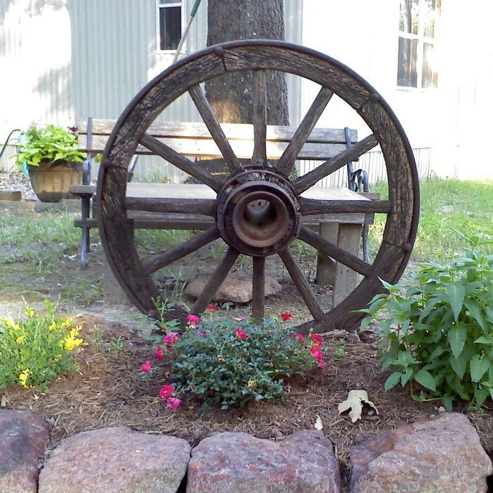 q iso suggestions for what s left of my wagon wheel, outdoor living, repurposing upcycling, rustic furniture, woodworking projects, BEFORE I could cry when I see this picture The wheel was a gift to my DH from a friend who moved away