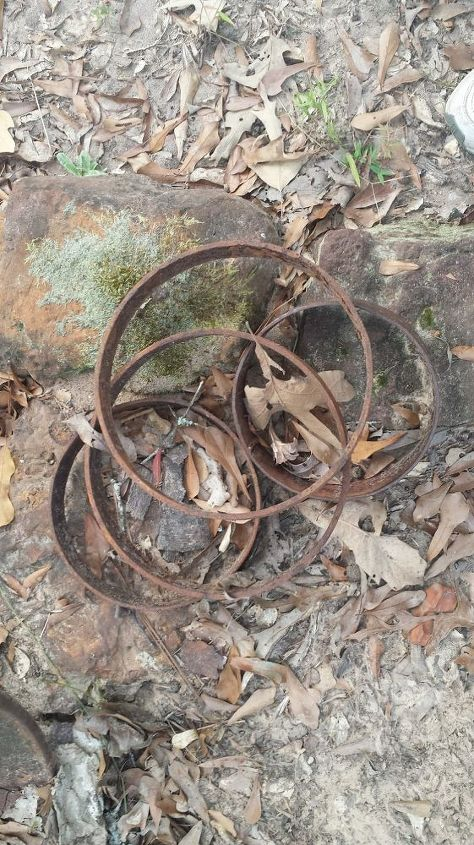 q iso suggestions for what s left of my wagon wheel, outdoor living, repurposing upcycling, rustic furniture, woodworking projects, Maybe wheels for a stationary wagon