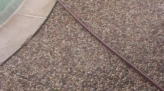 , Horrible pea gravel and coping breaking