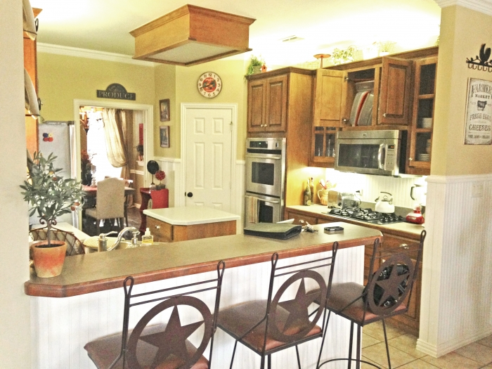 The old kitchen contained less floor space and featured a more ranch style. (Photo courtesy of Creative Elements)