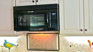, Cabinets over and around the existing stove finished I believe it was a three or four stage painting process in antique off white The splash behind the stove was cut from the new quarts counter top that the sink hole was cut from