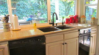 , Sink and dishwasher area Replaced wooden french windows with double pane vinyl
