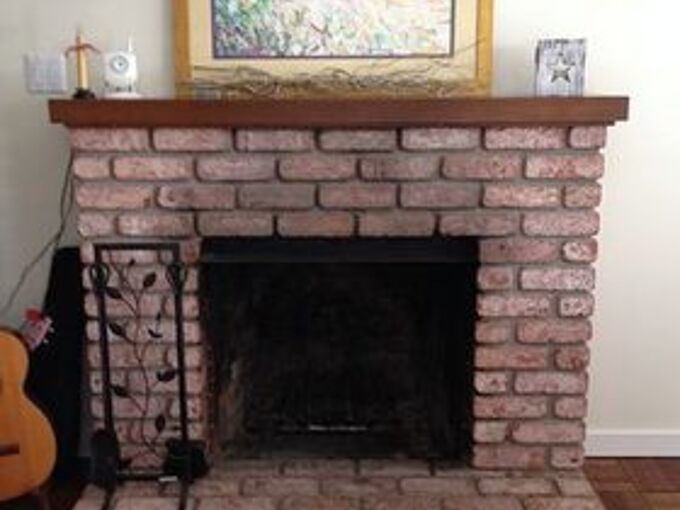 easy fireplace makeover whitewash the brick, concrete masonry, fireplaces mantels, painting, Our fireplace before