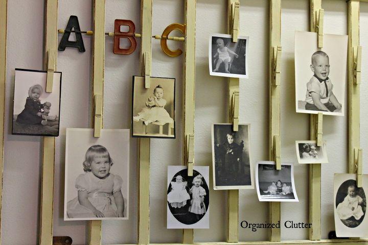 family baby photos displayed on a vintage crib rail, repurposing upcycling, wall decor