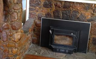 q help old stain has yellowed natural stone on my fireplace, cleaning tips, concrete masonry, fireplaces mantels, The stone below the stove is not stained The stained stone has that ugly orange hue to it Is there any way to cover over it or remove it altogether