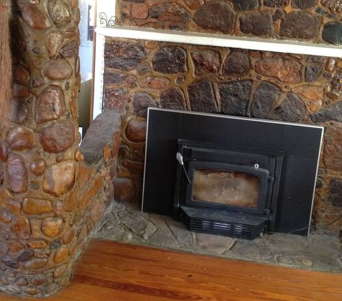 old stone fireplace. The stone below the stove is not stained  has that ugly orange Help Old stain yellowed natural on my fireplace Hometalk
