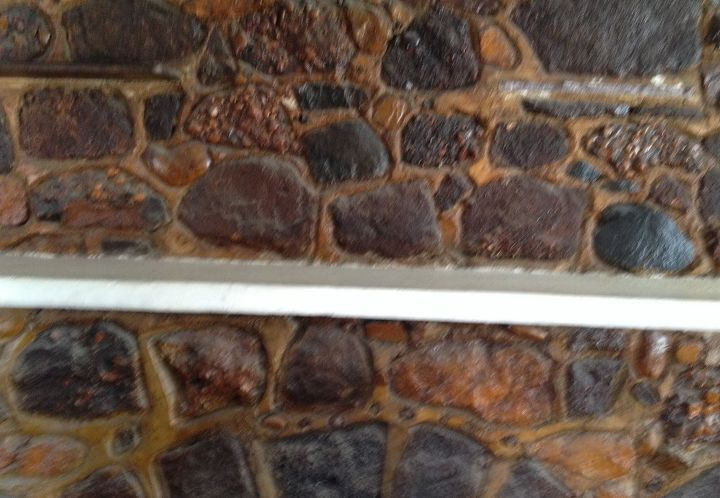 q help old stain has yellowed natural stone on my fireplace, cleaning tips, concrete masonry, fireplaces mantels, This is a close up of the stained stone I would love to see it in its natural state