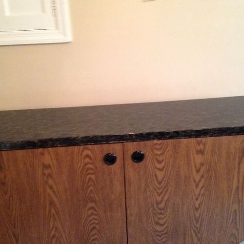 After I redid the top. What color should I paint the bottem, my cabinets are the plain oak