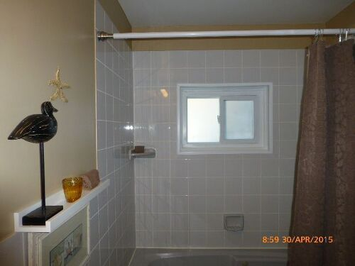 need the privacy as the neighbors window looks directly into the bathroom who puts a window in a shower and bath stall - Bathroom Windows