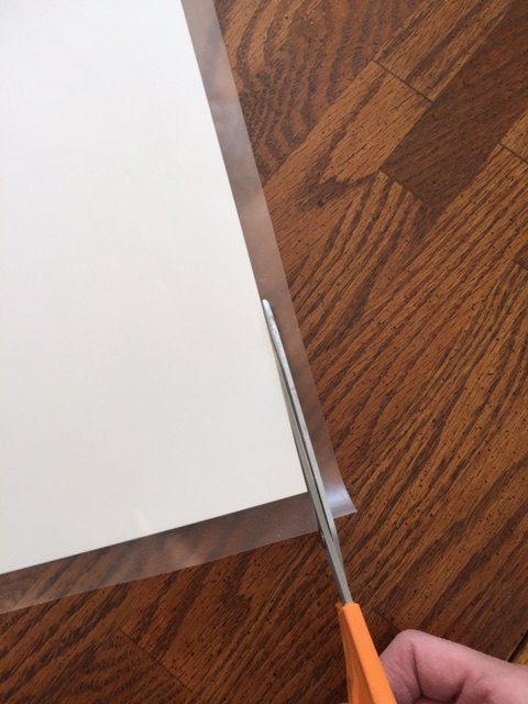 Trim excess Con-Tact paper from  cardstock