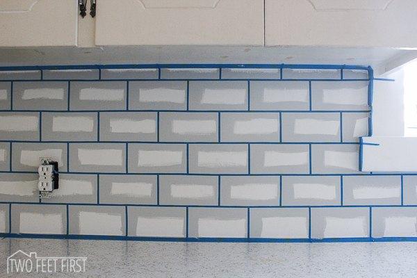 Diy cheap subway tile backsplash hometalk for Can you paint over glass tile backsplash