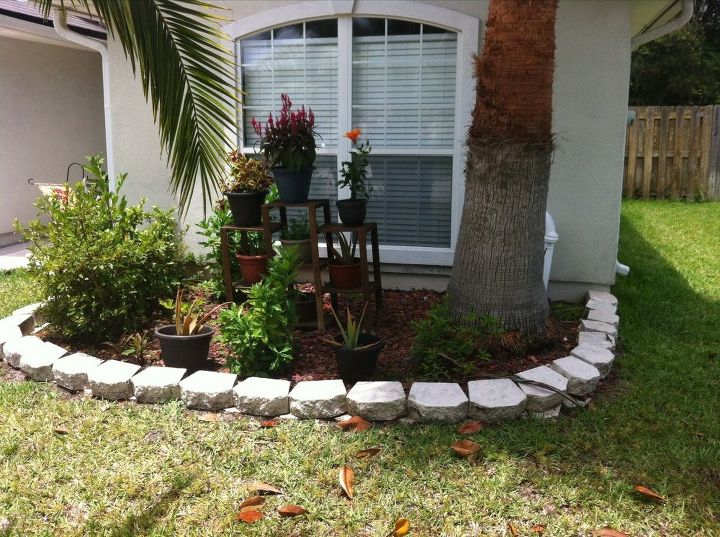 q ideas for beautiful and inexpensive backyard, gardening, outdoor living, patio, We love this he had potted all the plants Just wanting to know anyone advise on different flowers we could put here We rent our home so we don t want to put anything permanant