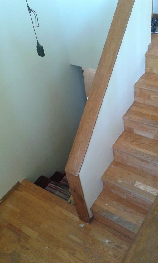split level stairs with high wall