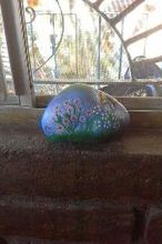 q using varnish or mug pod to finish rock painting, crafts, My first rock painting I took the rock from my husband s friends house his mother passed away like a year ago and he took over his mother s graden I have seen some rock painting in hometalk thought it will be nice