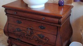 , Each drawer had to have cut outs made to fit around the pipes It did not compromise on the storage