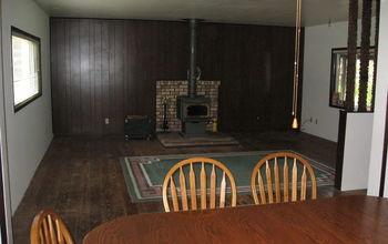 Bare Plank Floor, Dark Wall Paneling, Broken Fire Brick Pad.