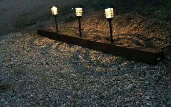 landscape timber to a lighted driveway, concrete masonry, outdoor living