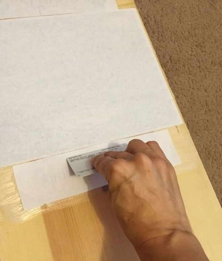 Use a plastic card to remove air bubbles