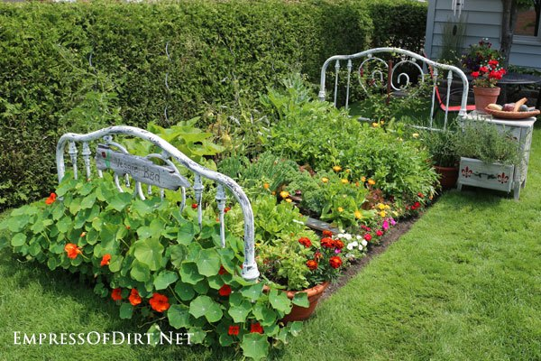 Repurposed bed frame to garden bed hometalk for Garden sectioning ideas