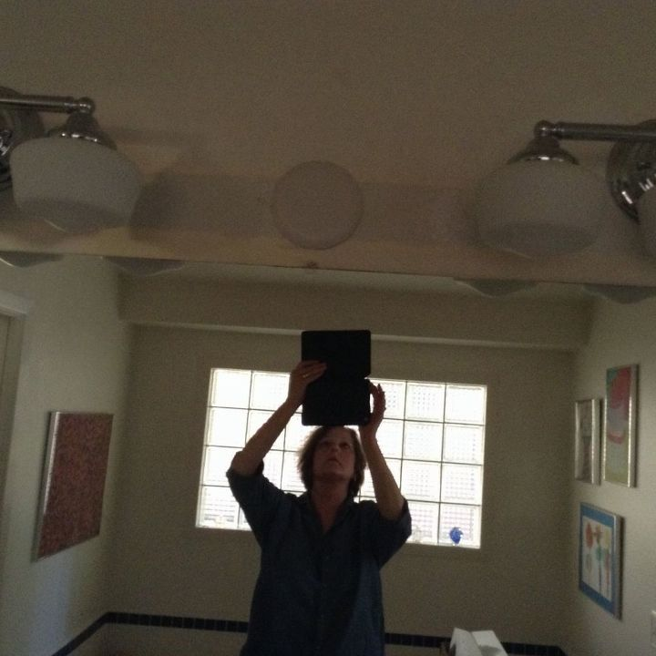 q how to cover a junction box cover over the bathroom mirror, bathroom ideas, home decor, how to, Ugly junction box