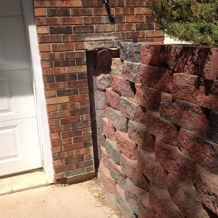 q how to repair or hide a hole in the wall, concrete masonry, home maintenance repairs, how to, I know I could put a large plant in front of it which is my second choice I am more curious about a possible repair or some way to cover it in a more subtle manner