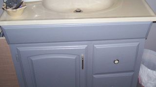 , I used a good latex paint and cleaned and prepped them carefully All of the cabinets were the dark oak
