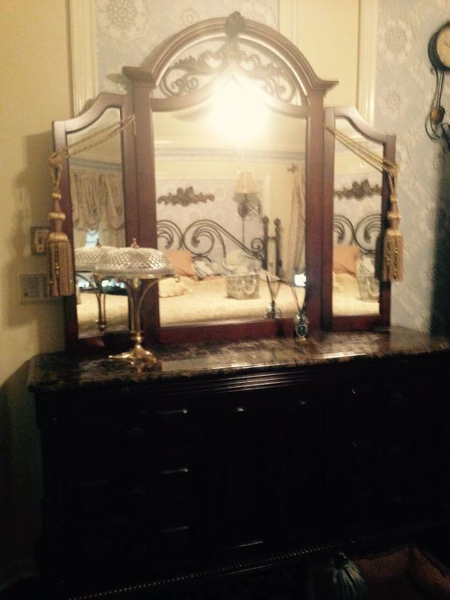 q suggestions on to update mediterranean bedroom furniture, bedroom ideas, painted furniture, I know removing the mirror from the dresser would help but there s still that dark marble top and all the iron scrollwork at the bottom