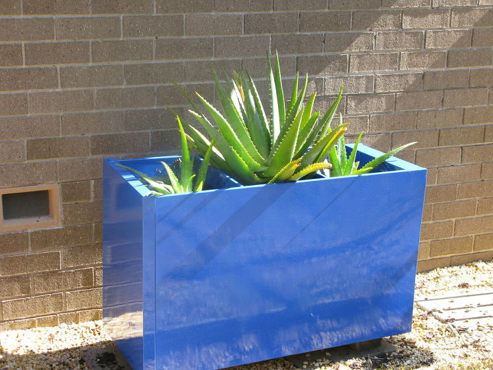 Beige File Cabinet to Blue Planter with Aloes