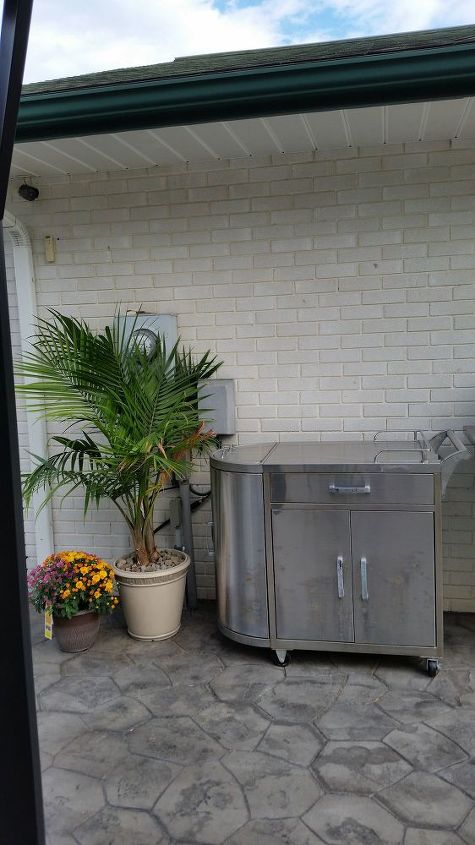 What can I do in this outdoor space to hide utility boxes/cables/etc ...