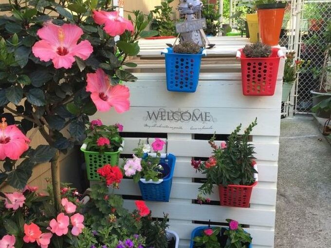 unsightly air conditioner covered with pallets and double as a planter, container gardening, gardening, hvac, pallet, repurposing upcycling, Side facing the streets