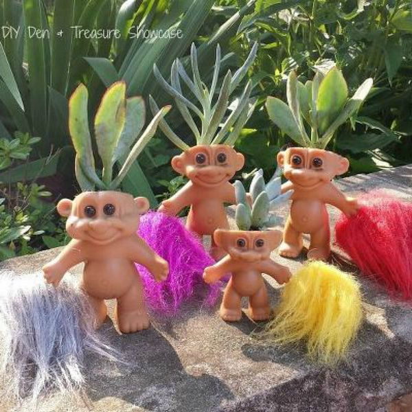 s 9 whimsical planters you didn t know you needed, container gardening, gardening, A Collection of Troll Dolls