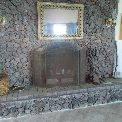 Painting a lava rock wall mantle | Hometalk