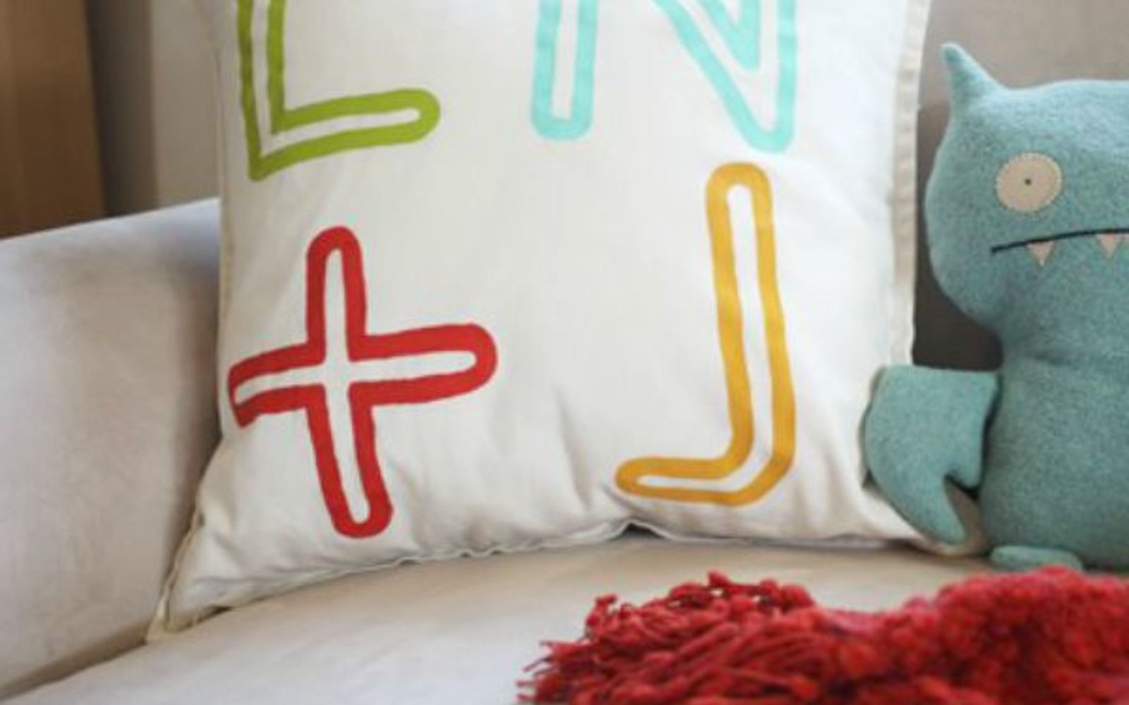 s 11 designer decor looks you can make on the cheap, crafts, home decor, Monogramed Pillow Cover Land of Nod