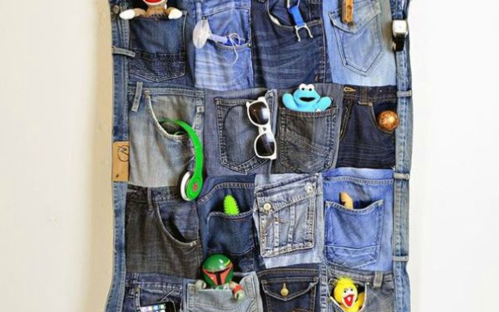 s 11 upcycles so simple you ll wonder why you ve never thought of them, crafts, repurposing upcycling, Turn Your Worn Jeans into Wall Organization