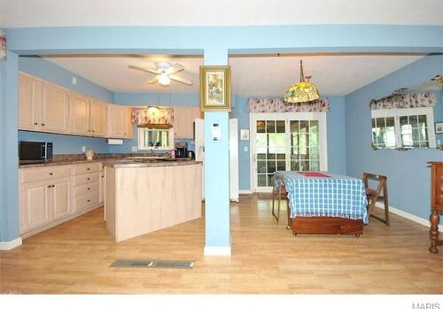 Open Floor Plan Kitchen Dining Living Room Area I Dont Like The Blue And Am Thinking Of A More Neutral Color For Walls