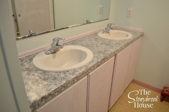 She tapes off the edges and sink in her church 39 s ladies - Faux marble bathroom countertops ...