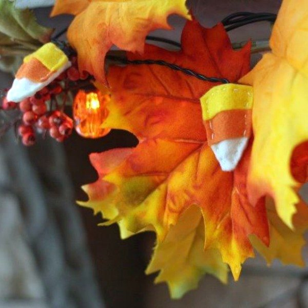 s 9 easy decor ideas inspired by delicious candy corn, seasonal holiday decor, wreaths, Scrumptious Glowing Garland